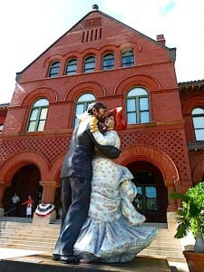 Gigantic dancers twirl in front of the Key West Customs House.