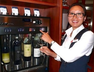 Bartender Neichulu demonstrates how to use the new wine dispensers in the Library Bar.