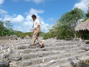 Guide Alex Cab shows how Mayans would have walked up the narrow steps at San Gervasio in Cozumel.