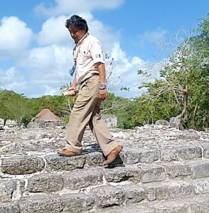 Alex Cab demonstrates how the Mayans walked on the narrow steps of the ruins in Cozumel.