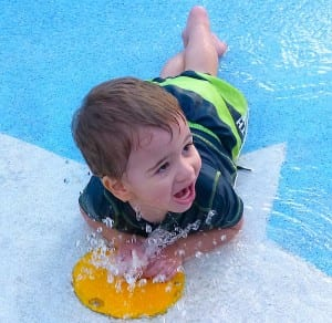 Mason Muldoon discovers a water spigot in the Disney Magic children's pool.