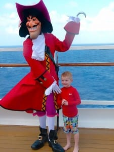 Ace Sowell poses for a photo aboard the Disney Magic with Captain Hook.