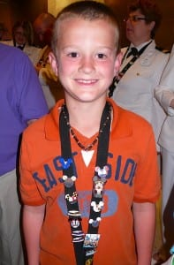 Jacob Marvel proudly poses with some of his Disney trading pins.