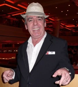 Ken Byrne, the Singing Maitre d', entertains on the new Carnival Breeze.