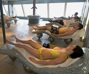 Heated porcelain lounges in the Carnival Magic spa warm and soothe tired muscles.