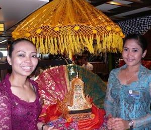 Eurodam crew members wear traditional dress for an Indonesian tea ceremony.