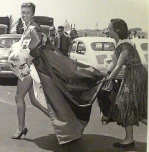 Esther Williams gets help on her long dress on the set of a move in Italy.