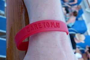 Melissa Mixon shows the wristband she wears as part of the fundraiser for St. Jude Children's Research Hospital.