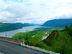 Historic Columbia River Highway has stone and white wooden fence railings.