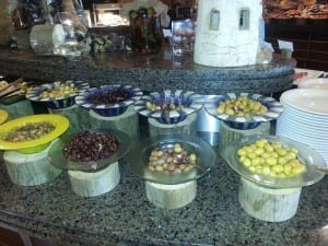 ten bowls of olives on the breakfast buffet