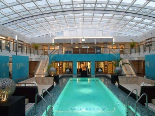 The mega swimming pool has a stunning, inviting setting; the magrodome roof overhead is closed during inclement weather.