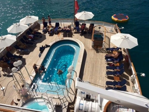 The pool is a favorite gathering place on ship