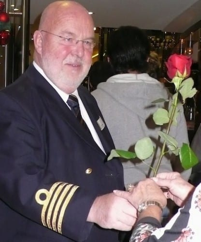 Captain Jan Tensen presents women passengers with a welcome-aboard rose. Photo by Jackie Sheckler Finch