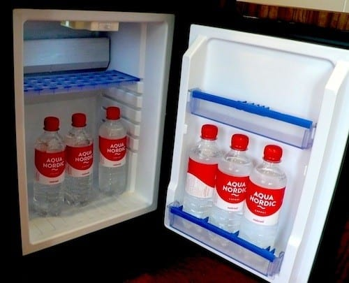 The fridge in my cabin is kept stocked with complimentary water.