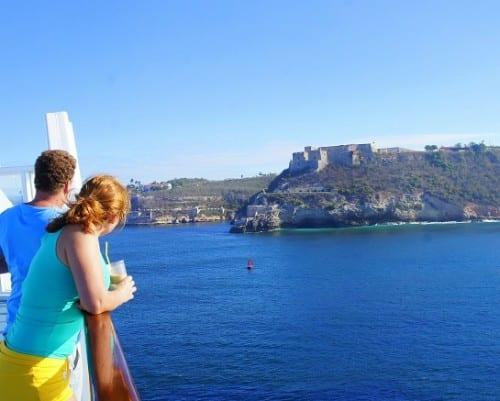 """Sailing  past """"El Morro"""" fortress at the entrance to Santiago de Cuba"""