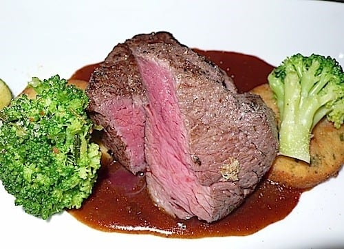 An entree of grilled beef tenderloin was prepared just right.