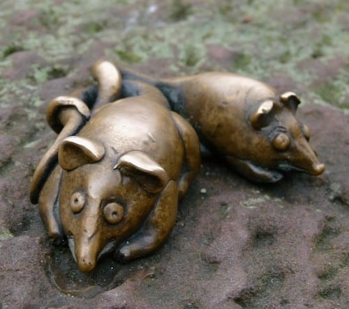Sculptures of two mice are nestled near the Bridge Monkey.
