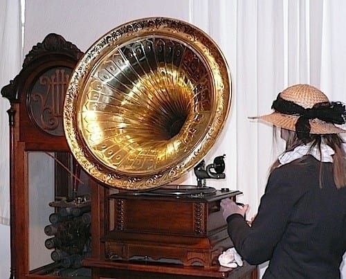 Guide Christelle cranks up an old gramophone which needs a new needle each time it is played.