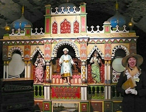 An ornate musical cabinet plays circus music.