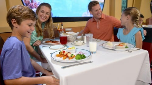 Families dining at Disney Cruise Line rotational dining restaurants, such as Animator's Palate can now choose a healthier option, Mickey Check children's meals. The Mickey Check makes it easier for parents and kids to identify meals that are nutritious, and is now available aboard all four Disney ships. (Ryan Wendler, photographer)