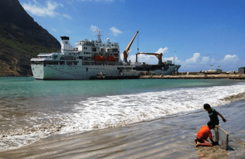 Aranui 3 unloading freight at Hakahau on the island of Ua Pou in the Marquesas of the South Pacific.