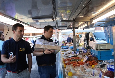 Captain Hadrian and Chef Luke shop the market for lunch and dinner.