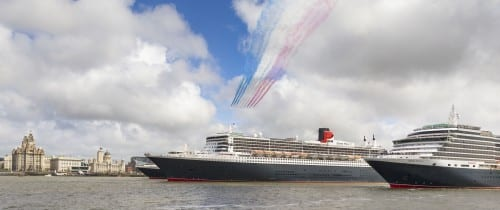 PICTURE PROVIDED FREE FOR EDITORIAL USE The Red Arrows in formation as Cunard's fleet gather together in spectacular fashion in Liverpool, its spiritual home, as the company marked its 175th anniversary. Left to right: Queen Elizabeth, Queen Mary 2, Queen Victoria. The historic lines' three ships, the largest passenger ships ever to muster together on the River Mersey, lined up just 130 metres apart. The vessels lined up three abreast at Liverpool's Pier Head beside its iconic Three Graces: The Royal Liver Building, The Cunard Building and The Port of Liverpool Building.  Picture date Monday 25th May, 2015. Picture by Christopher Ison. Contact +447544 044177 chris@christopherison.com