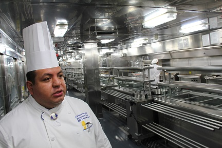 HAL 2nd Executive Chef Pablo Cesar Samudio leads galley tour during Noordam Alaska voyage.