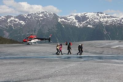 Helicopter landing on Taku Glacier, Juneau, AK