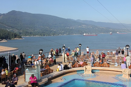 Passengers throng  Lido Deck as Noordam departs Vancouver, bound for Alaska.