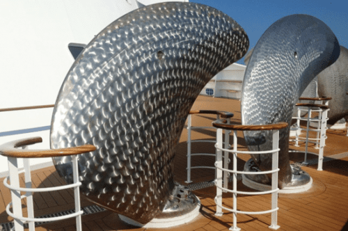Artwork on Queen Mary 2? No, spare propeller blades for a big ship