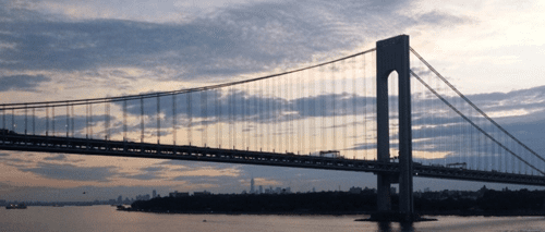 Queen Mary 2 nears the Verrazano-Narrows Bridge at 5:34 a.m., the New York skyline ahead