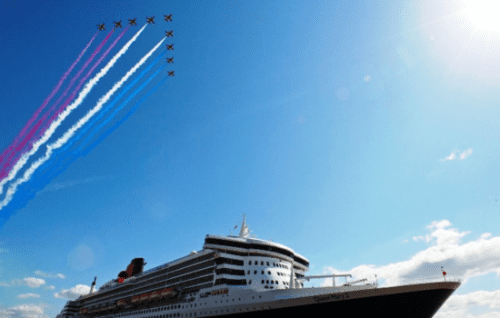 Red Arrows of the Royal Air Force fly over Queen Mary 2 in Liverpool, England