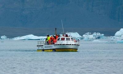 Amphibian vehicles explore the glacier lagoon.