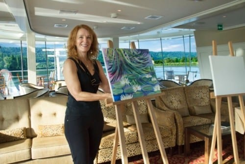 Artist Elizabeth Grebler readies for a painting session with passengers