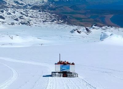 A snow cat heads back down the glacier.