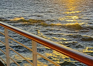 Sunset on waves in Baltic Sea from Eurodam cruise ship.