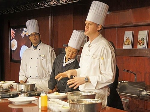 Cooking demonstration by chefs of the three Eurodam specialty restaurants: (l to r) Cannaletto, Tamarind, and The Pinnacle Grill.