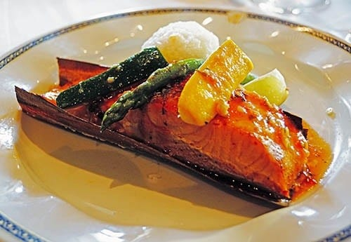 Cedar-baked red curry-coconut salmon  is a Culinary Council member selection by Master Chef Rudi Sodamn on menu of  the main Rembrandt Dining Room .
