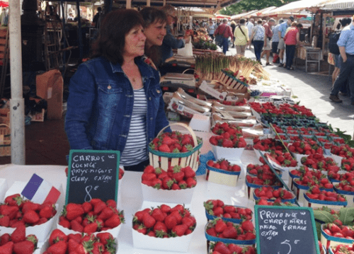 Teresa, a food merchant at the market in Nice, calls herself Queen of the Strawberries