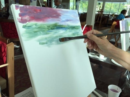 A novice painter begins her Giverny lily pads - photo by Timothy Leland
