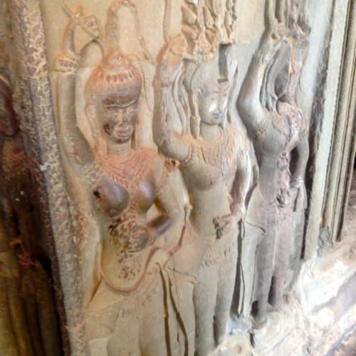 A triad of dancing beauties at Angkor Wat.
