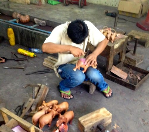 Wood carver in the workshops of Artisans of Angkor.