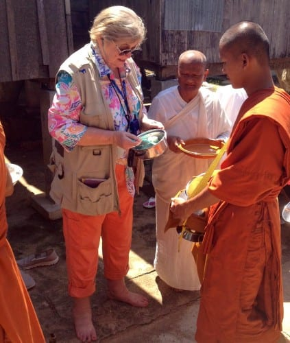 Travel writer Judy Wells joins the nuns to feed the monks in Oudong Monastery Center.