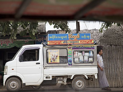 A local vendor awaits customers in Pakokku