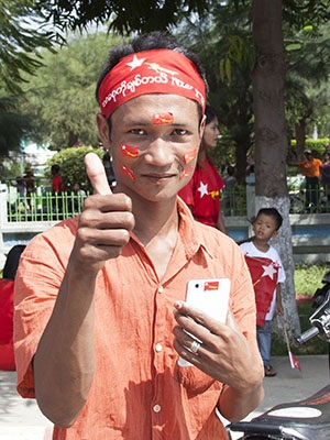 Enthusiastic supporter of Aung San Suu Kyi at rally in Sagaing