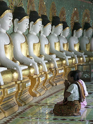 Praying at Umin Thounzeh Temple's 45 Buddha images