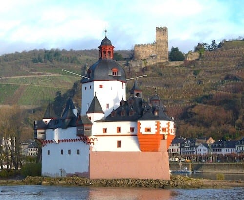 A landmark building looks as though it is a ship sailing on the Rhine.