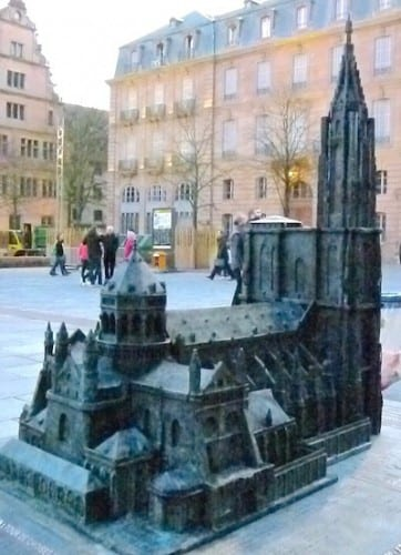 A model of the Strasbourg Cathedral is displayed outside the real thing.