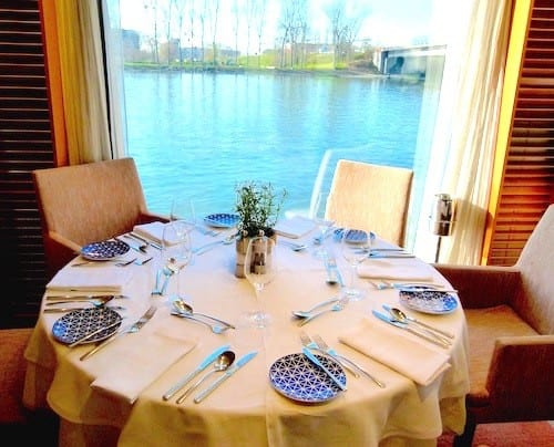 Floor to ceiling windows provide changing river scenes in the restaurant.